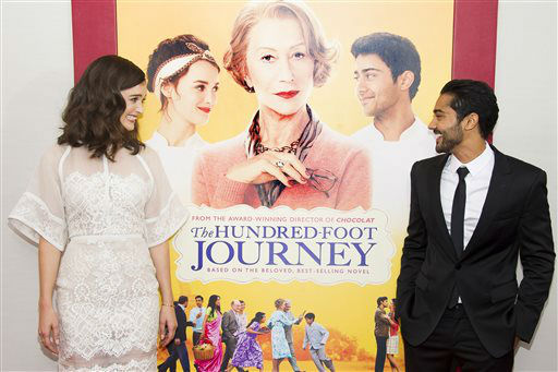 Charlotte Le Bon and Manish Dayal attend &#34;The Hundred-Foot Journey&#34; premiere on Monday, August 4, 2014 in New York. &#40;Photo by Charles Sykes&#47;Invision&#47;AP&#41; <span class=meta>(Photo&#47;Charles Sykes)</span>