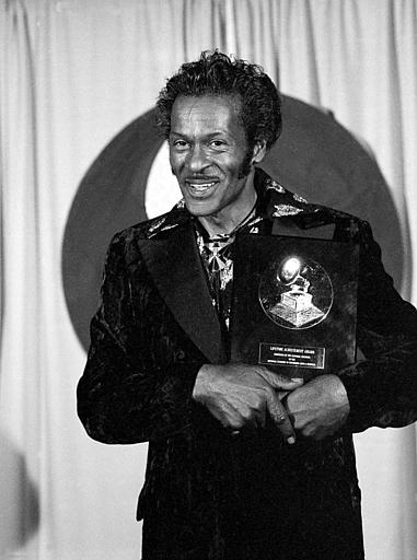 <div class='meta'><div class='origin-logo' data-origin='AP'></div><span class='caption-text' data-credit='AP'>American singer and guitarist Chuck Berry poses with his Lifetime Achievement Award Feb. 28, 1984.</span></div>