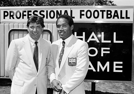<div class='meta'><div class='origin-logo' data-origin='none'></div><span class='caption-text' data-credit='AP Photo/Mark Duncan'>Football greats Joe Namath,  and O. J. Simpson,  stand in front of the Pro Football Hall of Fame in  Ohio, a day before their official induction into the sports shrine in 1985.</span></div>