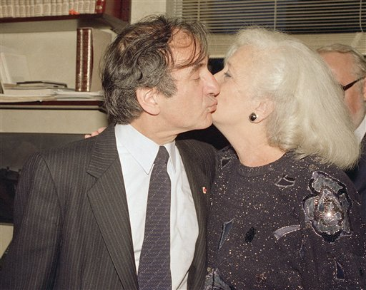 "<div class=""meta image-caption""><div class=""origin-logo origin-image ap""><span>AP</span></div><span class=""caption-text"">Author and death camp survivor Elie Wiesel kisses his wife Marion as they greet the press in their apartment in New York, Oct. 14, 1986. (Richard Drew)</span></div>"