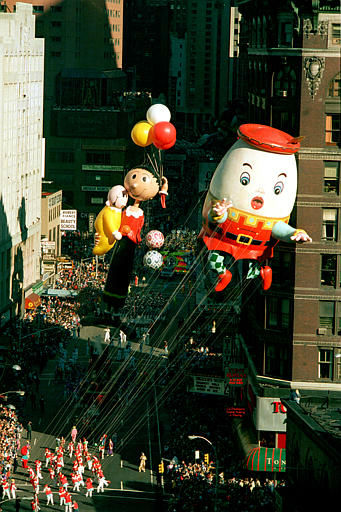<div class='meta'><div class='origin-logo' data-origin='none'></div><span class='caption-text' data-credit=''>The new Humpty Dumpty balloon, followed by a redesigned Olive Oyl holding Swee' Pea, floats down Broadway on Thursday, Nov. 27, 1986.</span></div>