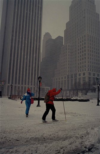 <div class='meta'><div class='origin-logo' data-origin='AP'></div><span class='caption-text' data-credit='AP'>An unidentified cross-country skier plants his poles as a pedestrian covers her face as she crosses New York's Fifth Avenue during a ferocious blizzard, March 13, 1993</span></div>