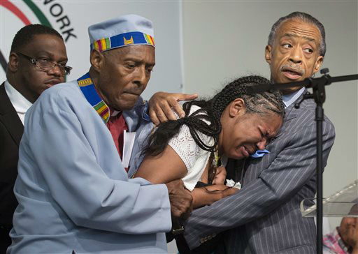 Esaw Garner, center, wife of Eric Garner, breaks down in the arms of Rev. Herbert Daughtry and Rev. Al Sharpton, right, during a rally at the National Action Network. <span class=meta>(AP Photo&#47; John Minchillo)</span>