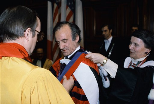 "<div class=""meta image-caption""><div class=""origin-logo origin-image ap""><span>AP</span></div><span class=""caption-text"">1986 Nobel Peace Prize winning writer Elie Wiesel, is awarded the rank of Doctor Honoris Causa (AP)</span></div>"