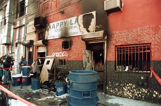 <div class='meta'><div class='origin-logo' data-origin='none'></div><span class='caption-text' data-credit='ASSOCIATED PRESS'>The charred facade of the Happy Land social club in the Bronx section of New York City is pictured in 1990.</span></div>