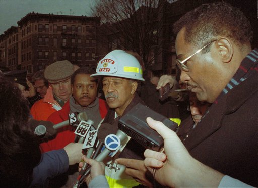 <div class='meta'><div class='origin-logo' data-origin='none'></div><span class='caption-text' data-credit='ASSOCIATED PRESS'>New York City Mayor David Dinkins speaks to news people at the scene of the Bronx, New York, social club fired which killed at least 87 people in 1990.</span></div>