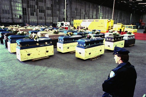 <div class='meta'><div class='origin-logo' data-origin='none'></div><span class='caption-text' data-credit='AP'>The bodies of 50 people killed in a Bronx social club fire lie in a hangar at Kennedy Airport in New York, March 31, 1990 prior to a midnight flight to Honduras. (Hilary Isaacs)</span></div>