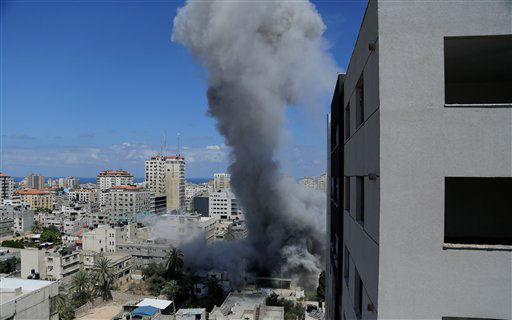 Smoke rises after an Israeli missile strike in Gaza City, Friday, July 18, 2014. Israel intensified its 11-day campaign against Hamas by sending in tanks and troops late Thursday.  <span class=meta>(AP Photo&#47; Hatem Moussa)</span>