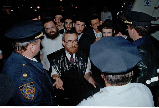 "<div class=""meta image-caption""><div class=""origin-logo origin-image none""><span>none</span></div><span class=""caption-text"">Orthodox Jews talk to police about more police presence to prevent further violence in the Crown Heights section of Brooklyn, N.Y., Aug. 21, 1991. (AP Photo/Andrew Savulich)</span></div>"