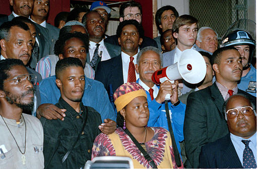 "<div class=""meta image-caption""><div class=""origin-logo origin-image none""><span>none</span></div><span class=""caption-text"">Mayor David Dinkins, with bullhorn, appeals to an angry crowd gathered at the home of 7-year-old Gavin Cato, whose death sparked rioting in Crown Heights, Aug. 22, 1991. (AP Photo/Joe Major)</span></div>"