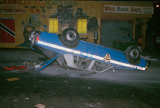 "<div class=""meta image-caption""><div class=""origin-logo origin-image none""><span>none</span></div><span class=""caption-text"">A New York City police car rests on its roof, Aug. 22, 1991. (AP Photo/Joe Major)</span></div>"
