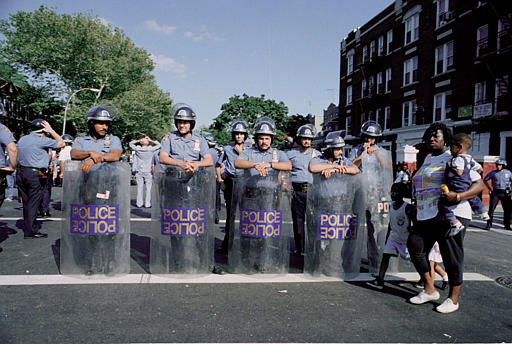 "<div class=""meta image-caption""><div class=""origin-logo origin-image none""><span>none</span></div><span class=""caption-text"">A group of police in full riot gear make up part of the massive police presence which temporarily quelled the Brooklyn, N.Y., Crown Heights neighborhood riots, Aug. 23, 1991. (AP Photo/David Cantor)</span></div>"