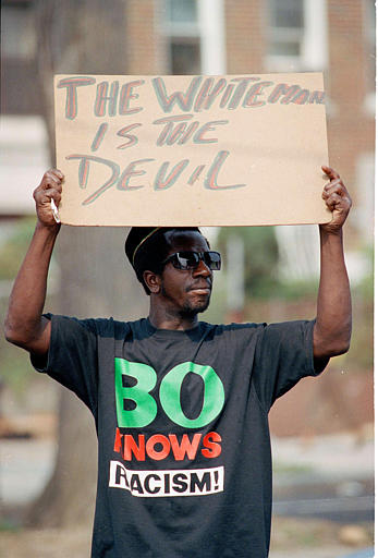 "<div class=""meta image-caption""><div class=""origin-logo origin-image none""><span>none</span></div><span class=""caption-text"">A demonstrator holds up a sign that reads ""The White Man is the Devil,"" outside Lubavitcher Synagogue in the Crown Heights section of Brooklyn, N.Y., Aug. 24, 1991. (AP Photo/Mark Lennihan)</span></div>"