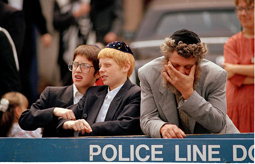 "<div class=""meta image-caption""><div class=""origin-logo origin-image none""><span>none</span></div><span class=""caption-text"">Orthodox Jews react as a crowd of angry black demonstrators approach the Lubavitcher Synagogue in the Crown Heights section of Brooklyn, N.Y., Aug. 25, 1991. (AP Photo/Mark Lennihan)</span></div>"