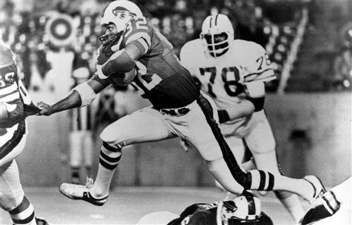 <div class='meta'><div class='origin-logo' data-origin='none'></div><span class='caption-text' data-credit='AP Photo/File'>Buffalo Bills running back O.J. Simpson (32), strides over teammates as he latches on to Joe DeLamielleurs during a football game against the Tampa Bay Buccaneers in Buffalo, N.Y.</span></div>