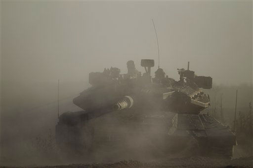 An Israeli tank takes a position along near the Israel-Gaza Border, Thursday, July 17, 2014. Photo&#47;Ariel Schalit&#41; <span class=meta>(AP Photo&#47; Ariel Schalit)</span>
