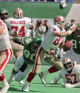 """<div class=""""meta image-caption""""><div class=""""origin-logo origin-image ap""""><span>AP</span></div><span class=""""caption-text"""">New York Jets defensive end Dennis Byrd puts the pressure on San Francisco 49er quarterback Steve Young as he looks for open man down field in the first quarter game, Sept 20, 1992 (AP)</span></div>"""
