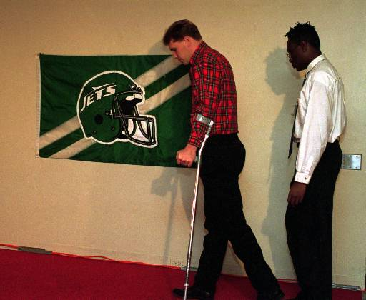"""<div class=""""meta image-caption""""><div class=""""origin-logo origin-image ap""""><span>AP</span></div><span class=""""caption-text"""">New York Jets defensive end Dennis Byrd, paralyzed in a collision with a teammate the season before, walks to his place at a New York news conference in February 1993. (AP)</span></div>"""