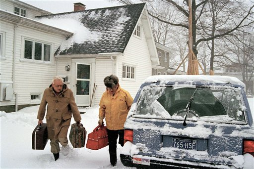 <div class='meta'><div class='origin-logo' data-origin='AP'></div><span class='caption-text' data-credit='AP'>Howard Truss, left, leaves his beach house with John Burgess in Old Greenwich, Connecticut, March 13, 1993</span></div>