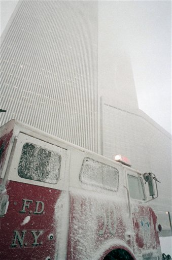 <div class='meta'><div class='origin-logo' data-origin='AP'></div><span class='caption-text' data-credit='AP'>A fire truck from New York's Ladder Company 50, with lights flashing, drives past the twin towers of the World Trade Center and the Vista Hotel</span></div>