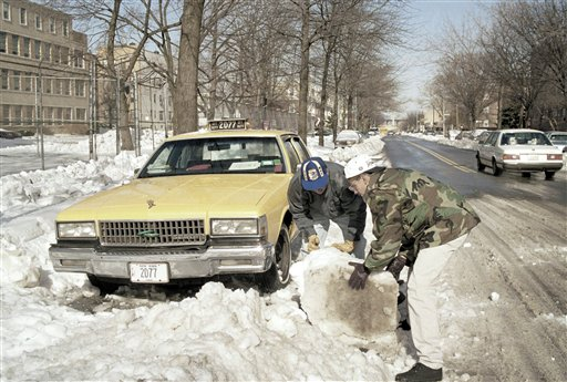 <div class='meta'><div class='origin-logo' data-origin='AP'></div><span class='caption-text' data-credit='AP'>Fernando Aguilan, left, gets some help from his son, Marco as they move a block of ice from in front of his taxi in Astoria, Queens, March 15, 1993.</span></div>