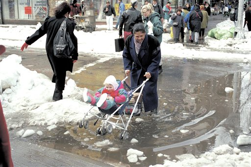 <div class='meta'><div class='origin-logo' data-origin='AP'></div><span class='caption-text' data-credit='AP'>A woman pushes a toddler in a stroller through ankle-deep water collected from melting snow in the Union Square area of New York City, March 16, 1993.</span></div>