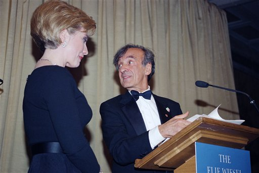 "<div class=""meta image-caption""><div class=""origin-logo origin-image ap""><span>AP</span></div><span class=""caption-text"">Hillary Rodham Clinton, left and Elie Wiesel stand at the podium as she accepts the Humanitarian Award from the Elie Wiesel Foundation in 1994. ((AP Photo/Kevin Larkin))</span></div>"