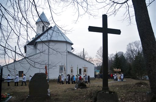 <div class='meta'><div class='origin-logo' data-origin='none'></div><span class='caption-text' data-credit='AP'>Devotees carry gonfalons during Easter Sunday rites in the village of Vselyub, 150 kilometers (93 miles) west of Minsk, Belarus. (AP Photo/Sergei Grits)</span></div>