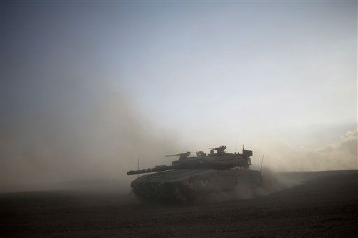 An Israeli tank maneuvers to take a position along the Israel-Gaza Border, Thursday, July 17, 2014.  <span class=meta>(AP Photo&#47; Ariel Schalit)</span>