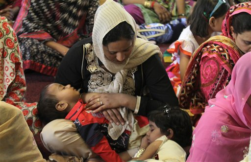 <div class='meta'><div class='origin-logo' data-origin='none'></div><span class='caption-text' data-credit='AP'>A Christian woman holds her children while she prays during an Easter service at St Anthony's Church in Lahore, Pakistan. (AP Photo/K.M. Chaudary)</span></div>
