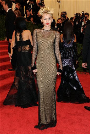 """<div class=""""meta image-caption""""><div class=""""origin-logo origin-image ap""""><span>AP</span></div><span class=""""caption-text"""">Singer Miley Cyrus attends The Metropolitan Museum of Art  Costume Institute gala benefit, on Monday, May 6, 2013 in New York. (Evan Agostini/Invision/AP)</span></div>"""