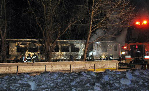 "<div class=""meta image-caption""><div class=""origin-logo origin-image none""><span>none</span></div><span class=""caption-text"">Emergency personnel work at the scene of a Metro-North Railroad passenger train and vehicle accident in Valhalla</span></div>"