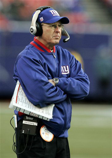"<div class=""meta image-caption""><div class=""origin-logo origin-image none""><span>none</span></div><span class=""caption-text"">Giants' coach Tom Coughlin looks from the sideline during their' 23-0 loss to the Carolina Panthers in a NFC wild card playoff football game on Jan. 8, 2006.  (AP Photo/ KATHY WILLENS)</span></div>"