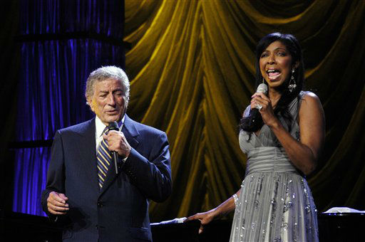 "<div class=""meta image-caption""><div class=""origin-logo origin-image none""><span>none</span></div><span class=""caption-text"">Tony Bennett sings a duet with Natalie Cole at the 106.7 Lite FM ""One Night With Lite"" concert in New York in 2006. ( AP Photo/ Jim Cooper)</span></div>"