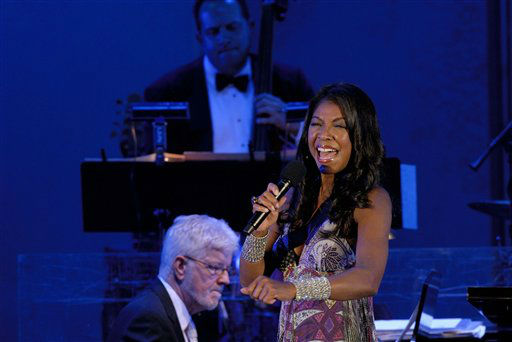 "<div class=""meta image-caption""><div class=""origin-logo origin-image none""><span>none</span></div><span class=""caption-text"">Natalie Cole belts out a song at the ""70th Birthday Celebration"" held on behalf of Nancy Wilson at the Hollywood Bowl in 2007.  (AP Photo/Earl Gibson III ) (AP Photo/ EARL GIBSON III)</span></div>"