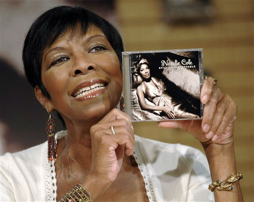 "<div class=""meta image-caption""><div class=""origin-logo origin-image none""><span>none</span></div><span class=""caption-text"">Natalie Cole poses with a copy of her new CD, ""Still Unforgettable,"" in Los Angeles in 2008. (AP Photo/Chris Pizzello) (AP Photo/ Chris Pizzello)</span></div>"