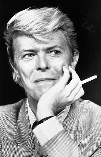 <div class='meta'><div class='origin-logo' data-origin='none'></div><span class='caption-text' data-credit='AP Photo/ XMF'>David Bowie sits holding a cigarette in Cannes, May, 1983. (AP Photo)</span></div>