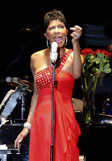 "<div class=""meta image-caption""><div class=""origin-logo origin-image none""><span>none</span></div><span class=""caption-text"">Natalie Cole performs during her concert ""2010 Live In Taipei"", in 2010 in Taiwan. (AP Photo/Chiang Ying-ying) (AP Photo/ Chiang Ying-ying)</span></div>"