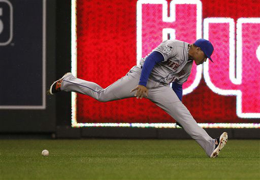 "<div class=""meta image-caption""><div class=""origin-logo origin-image none""><span>none</span></div><span class=""caption-text"">New York Mets center fielder Juan Lagares can make the play on a fly ball by Kansas City Royals' Eric Hosmer during the fourth inning.  (AP Photo/ Matt Slocum)</span></div>"