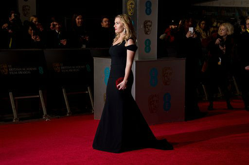 """<div class=""""meta image-caption""""><div class=""""origin-logo origin-image none""""><span>none</span></div><span class=""""caption-text"""">Kate Winslet poses for photographers upon arrival.  (Photo by Jonathan Short/Invision)</span></div>"""