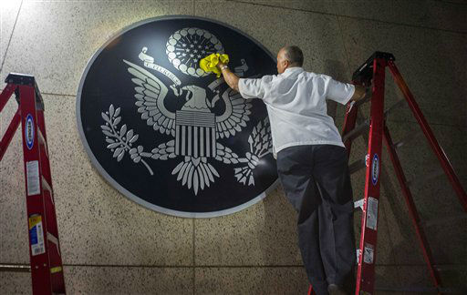 "<div class=""meta image-caption""><div class=""origin-logo origin-image none""><span>none</span></div><span class=""caption-text"">A worker wipes a representation of the The Great Seal of the United States at the newly opened U.S. Embassy in Havana, Cuba.(AP Photo/Ramon Espinosa) (AP Photo/ Ramon Espinosa)</span></div>"