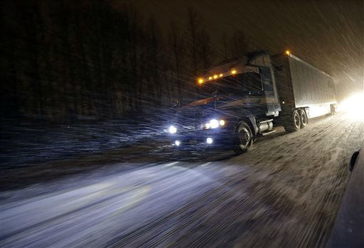 <div class='meta'><div class='origin-logo' data-origin='none'></div><span class='caption-text' data-credit='AP Photo/ Mel Evans'>A tractor trailer rig drives during a snowstorm along the Atlantic City Expressway,  Friday, Jan. 22, 2016, near Atlantic City.</span></div>