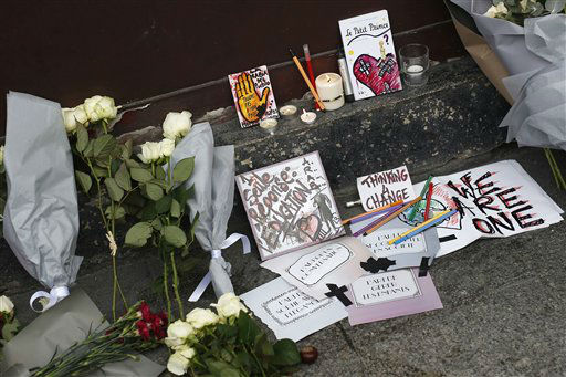"""<div class=""""meta image-caption""""><div class=""""origin-logo origin-image none""""><span>none</span></div><span class=""""caption-text"""">Cards, candles and flowers are placed in front of the Carillon cafe in Paris Saturday Nov. 14, 2015. (AP Photo/ Jerome Delay)</span></div>"""