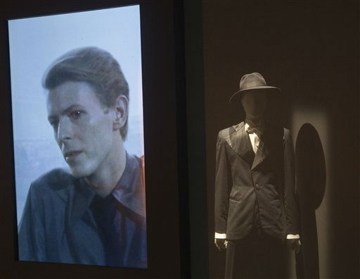 "<div class=""meta image-caption""><div class=""origin-logo origin-image none""><span>none</span></div><span class=""caption-text"">David Bowie appears on a giant screen with various costumes he performed in, as part of a retrospective David Bowie exhibition.(AP Photo/Jacques Brinon) (AP Photo/ Jacques Brinon)</span></div>"