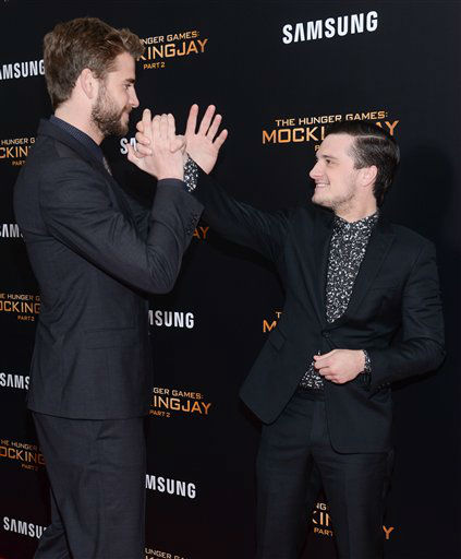 """<div class=""""meta image-caption""""><div class=""""origin-logo origin-image none""""><span>none</span></div><span class=""""caption-text"""">Liam Hemsworth, left, and Josh Hutcherson greet each other on the red carpet at a special screening of """"The Hunger Games: Mockingjay Part 2"""" in New York. </span></div>"""