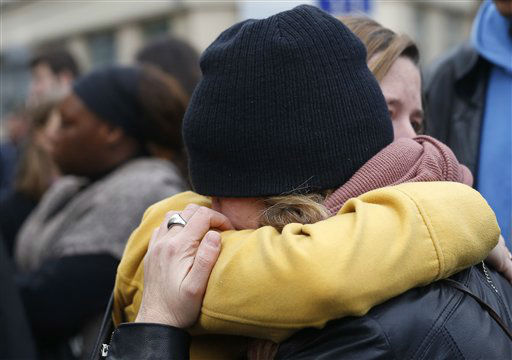 """<div class=""""meta image-caption""""><div class=""""origin-logo origin-image none""""><span>none</span></div><span class=""""caption-text"""">People hug in the street in front  of the Carillon cafe and the Petit Cambodge restaurant  in Paris Saturday Nov. 14, 2015. (AP Photo/ Jerome Delay)</span></div>"""