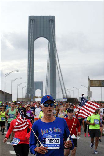 <div class='meta'><div class='origin-logo' data-origin='none'></div><span class='caption-text' data-credit='AP Photo/ Jason DeCrow'>Runners cross the Verrazano-Narrows Bridge at the start of the New York City Marathon, Sunday, Nov. 1, 2015, in New York.</span></div>