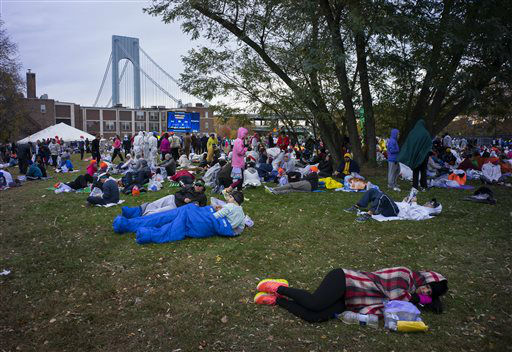 <div class='meta'><div class='origin-logo' data-origin='none'></div><span class='caption-text' data-credit='AP Photo/ Craig Ruttle'>Runners rest near the starting line before the New York City Marathon in the Staten Island borough of New York Sunday, Nov. 1, 2015.</span></div>
