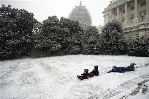 <div class='meta'><div class='origin-logo' data-origin='none'></div><span class='caption-text' data-credit='AP Photo/ Alex Brandon'>Ben Cichy slips as he pushes his sons Adrian, 18 months, and Logan 3, as they sled in the snow on Capitol Hill, Friday, Jan. 22, 2016 in Washington.</span></div>
