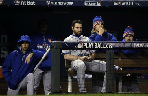 "<div class=""meta image-caption""><div class=""origin-logo origin-image none""><span>none</span></div><span class=""caption-text"">Some New York Mets watch from the dugout during the eighth inning. (AP Photo/David J. Phillip) (AP Photo/ David J. Phillip)</span></div>"
